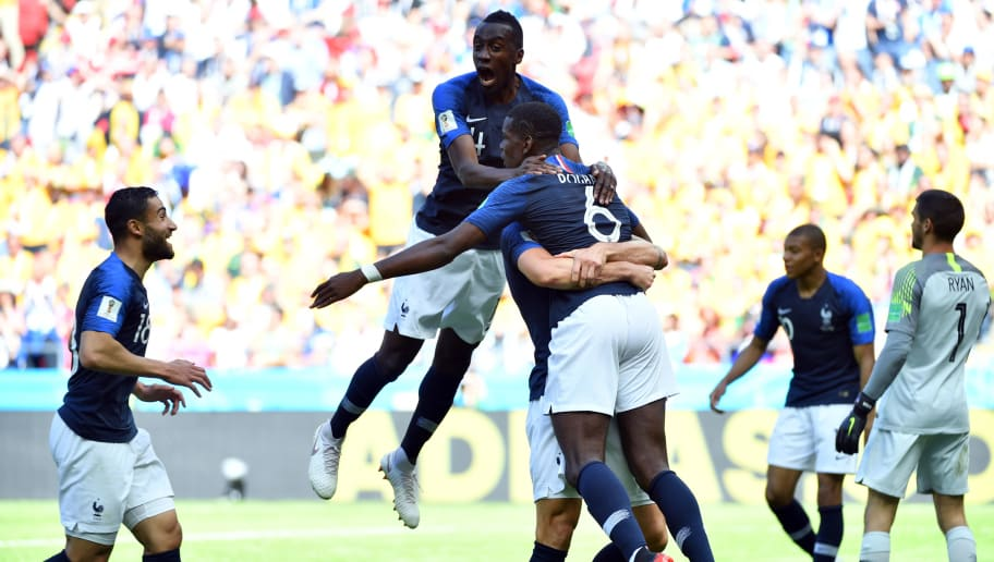 TOPSHOT - France's midfielder Paul Pogba (6) celebrates with teammates after scoring their second goal during the Russia 2018 World Cup Group C football match between France and Australia at the Kazan Arena in Kazan on June 16, 2018. (Photo by SAEED KHAN / AFP) / RESTRICTED TO EDITORIAL USE - NO MOBILE PUSH ALERTS/DOWNLOADS        (Photo credit should read SAEED KHAN/AFP/Getty Images)