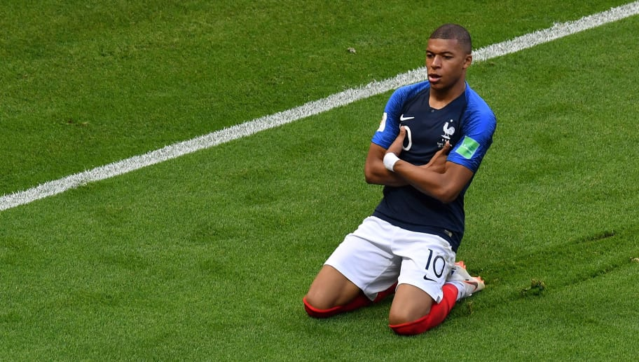 TOPSHOT - France's Kylian Mbappe celebrates after scoring his team's third goal during the Russia 2018 World Cup round of 16 football match between France and Argentina at the Kazan Arena in Kazan on June 30, 2018. (Photo by SAEED KHAN / AFP) / RESTRICTED TO EDITORIAL USE - NO MOBILE PUSH ALERTS/DOWNLOADS        (Photo credit should read SAEED KHAN/AFP/Getty Images)
