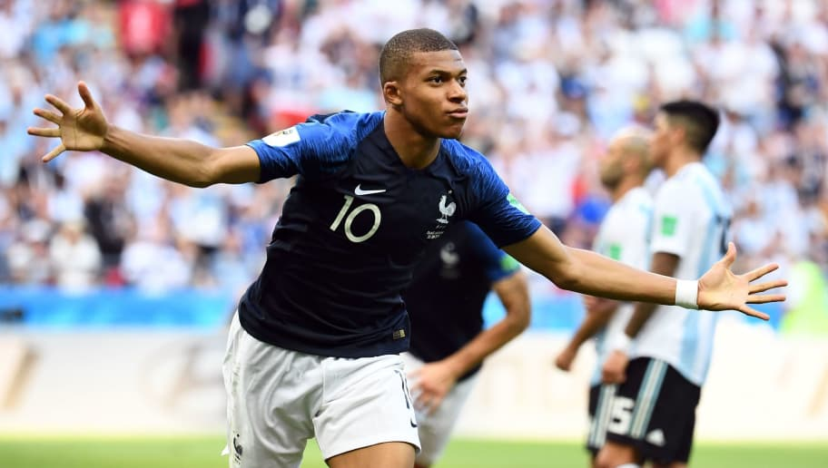 TOPSHOT - France's forward Kylian Mbappe celebrates after scoring their third goal during the Russia 2018 World Cup round of 16 football match between France and Argentina at the Kazan Arena in Kazan on June 30, 2018. (Photo by FRANCK FIFE / AFP) / RESTRICTED TO EDITORIAL USE - NO MOBILE PUSH ALERTS/DOWNLOADS        (Photo credit should read FRANCK FIFE/AFP/Getty Images)