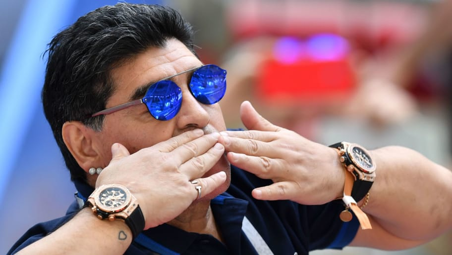 TOPSHOT - Retired Argentina player Diego Maradona attends the Russia 2018 World Cup round of 16 football match between France and Argentina at the Kazan Arena in Kazan on June 30, 2018. (Photo by SAEED KHAN / AFP) / RESTRICTED TO EDITORIAL USE - NO MOBILE PUSH ALERTS/DOWNLOADS        (Photo credit should read SAEED KHAN/AFP/Getty Images)