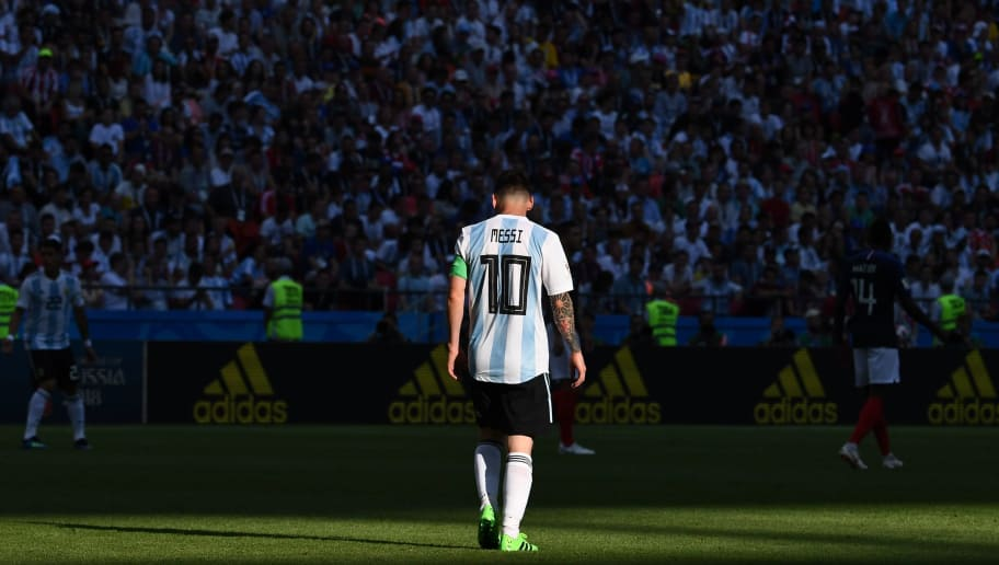 TOPSHOT - Argentina's forward Lionel Messi walks on the pitch during the Russia 2018 World Cup round of 16 football match between France and Argentina at the Kazan Arena in Kazan on June 30, 2018. (Photo by FRANCK FIFE / AFP) / RESTRICTED TO EDITORIAL USE - NO MOBILE PUSH ALERTS/DOWNLOADS        (Photo credit should read FRANCK FIFE/AFP/Getty Images)