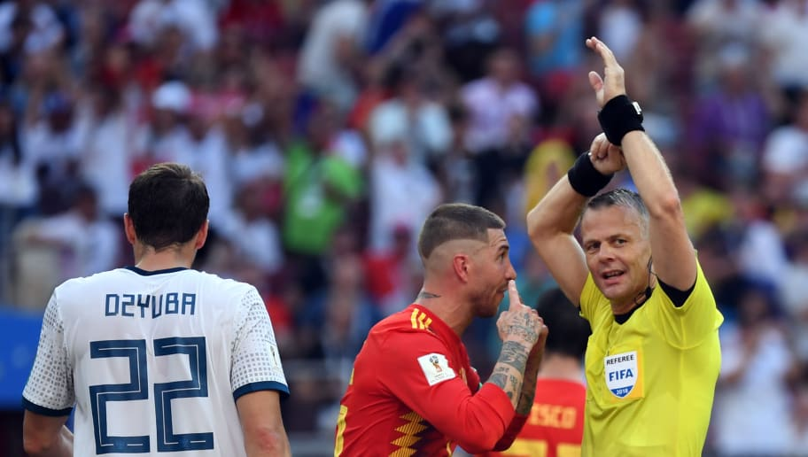 TOPSHOT - Spain's defender Sergio Ramos (C) argues with Dutch referee Bjorn Kuipers indicating a handball during the Russia 2018 World Cup round of 16 football match between Spain and Russia at the Luzhniki Stadium in Moscow on July 1, 2018. (Photo by Kirill KUDRYAVTSEV / AFP) / RESTRICTED TO EDITORIAL USE - NO MOBILE PUSH ALERTS/DOWNLOADS        (Photo credit should read KIRILL KUDRYAVTSEV/AFP/Getty Images)