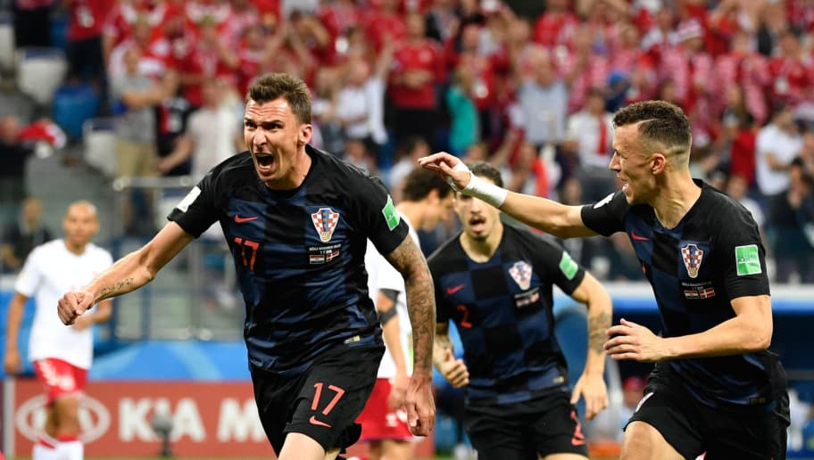 TOPSHOT - Croatia's forward Mario Mandzukic celebrates with teammates after scoring the team's first goal during the Russia 2018 World Cup round of 16 football match between Croatia and Denmark at the Nizhny Novgorod Stadium in Nizhny Novgorod on July 1, 2018. (Photo by Alexander NEMENOV / AFP) / RESTRICTED TO EDITORIAL USE - NO MOBILE PUSH ALERTS/DOWNLOADS        (Photo credit should read ALEXANDER NEMENOV/AFP/Getty Images)