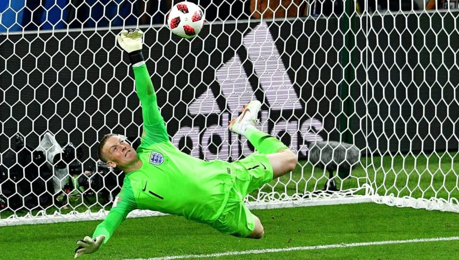 TOPSHOT - England's goalkeeper Jordan Pickford saves a penalty kicked by Colombia's forward Carlos Bacca during the penalty shootouts during the Russia 2018 World Cup round of 16 football match between Colombia and England at the Spartak Stadium in Moscow on July 3, 2018. (Photo by Mladen ANTONOV / AFP) / RESTRICTED TO EDITORIAL USE - NO MOBILE PUSH ALERTS/DOWNLOADS        (Photo credit should read MLADEN ANTONOV/AFP/Getty Images)