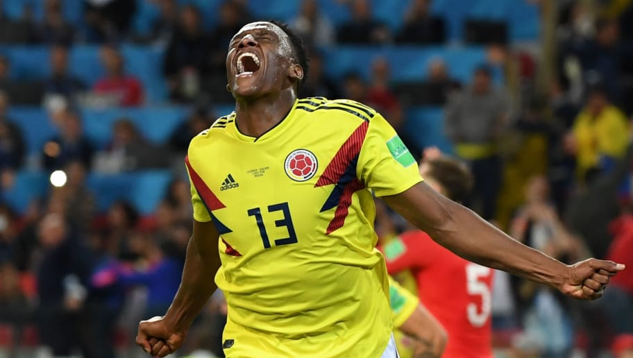 TOPSHOT - Colombia's defender Yerry Mina celebrates after scoring the equalizer during the Russia 2018 World Cup round of 16 football match between Colombia and England at the Spartak Stadium in Moscow on July 3, 2018. (Photo by YURI CORTEZ / AFP) / RESTRICTED TO EDITORIAL USE - NO MOBILE PUSH ALERTS/DOWNLOADS        (Photo credit should read YURI CORTEZ/AFP/Getty Images)