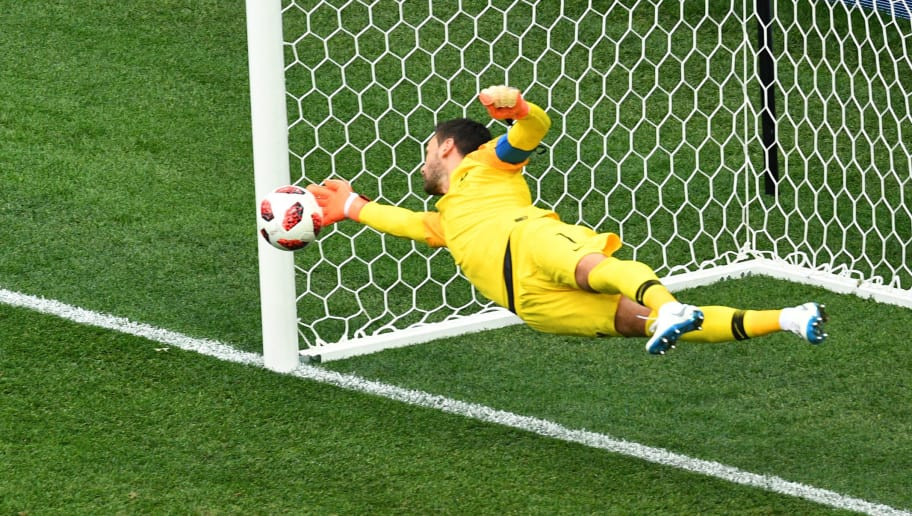 TOPSHOT - France's goalkeeper Hugo Lloris dives to make a save during the Russia 2018 World Cup quarter-final football match between Uruguay and France at the Nizhny Novgorod Stadium in Nizhny Novgorod on July 6, 2018. (Photo by Johannes EISELE / AFP)        (Photo credit should read JOHANNES EISELE/AFP/Getty Images)