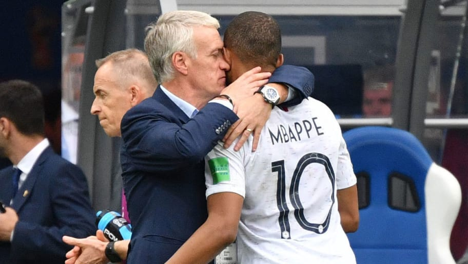 TOPSHOT - France's coach Didier Deschamps (L) speaks with France's forward Kylian Mbappe during the Russia 2018 World Cup quarter-final football match between Uruguay and France at the Nizhny Novgorod Stadium in Nizhny Novgorod on July 6, 2018. (Photo by Dimitar DILKOFF / AFP)        (Photo credit should read DIMITAR DILKOFF/AFP/Getty Images)