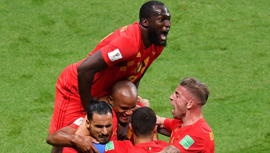 TOPSHOT - Belgium's forward Romelu Lukaku jumps over teammates to celebrate Brazil's own goal during the Russia 2018 World Cup quarter-final football match between Brazil and Belgium at the Kazan Arena in Kazan on July 6, 2018. (Photo by SAEED KHAN / AFP) / RESTRICTED TO EDITORIAL USE - NO MOBILE PUSH ALERTS/DOWNLOADS        (Photo credit should read SAEED KHAN/AFP/Getty Images)
