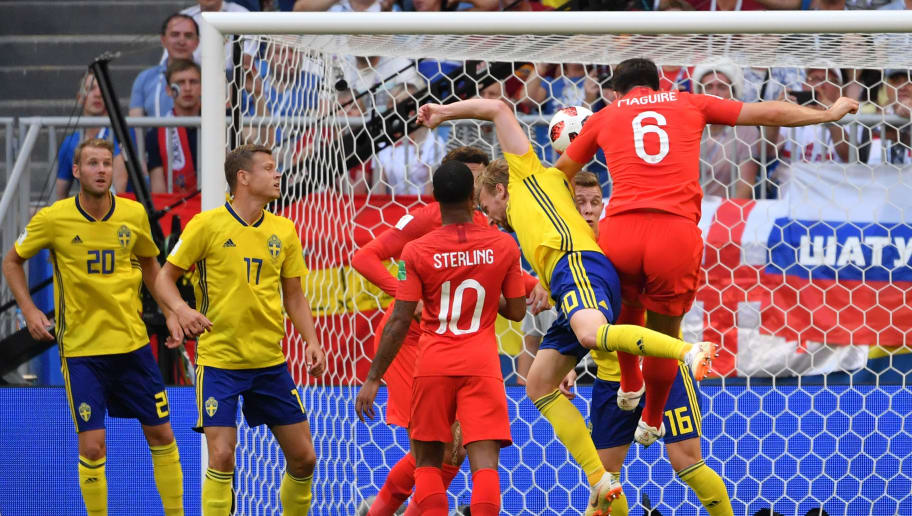 TOPSHOT - England's defender Harry Maguire (R) heads to score the opener during the Russia 2018 World Cup quarter-final football match between Sweden and England at the Samara Arena in Samara on July 7, 2018. (Photo by EMMANUEL DUNAND / AFP) / RESTRICTED TO EDITORIAL USE - NO MOBILE PUSH ALERTS/DOWNLOADS        (Photo credit should read EMMANUEL DUNAND/AFP/Getty Images)