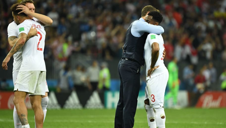 TOPSHOT - England's coach Gareth Southgate (2ndR) comforts England's defender Danny Rose (R) as England's defender Phil Jones (L) hugs England's defender Kyle Walker at the end of the Russia 2018 World Cup semi-final football match between Croatia and England at the Luzhniki Stadium in Moscow on July 11, 2018. (Photo by Kirill KUDRYAVTSEV / AFP) / RESTRICTED TO EDITORIAL USE - NO MOBILE PUSH ALERTS/DOWNLOADS        (Photo credit should read KIRILL KUDRYAVTSEV/AFP/Getty Images)