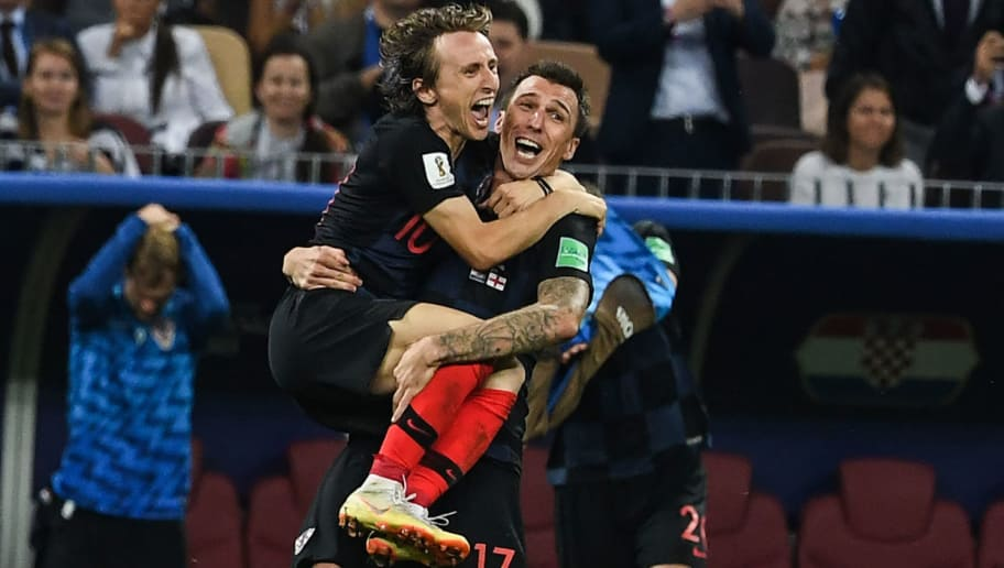 TOPSHOT - Croatia's midfielder Luka Modric and Croatia's forward Mario Mandzukic celebrate their win at the end of the Russia 2018 World Cup semi-final football match between Croatia and England at the Luzhniki Stadium in Moscow on July 11, 2018. - Croatia will play France in the World Cup final after they beat England 2-1 in extra-time on Wednesday thanks to a Mario Mandzukic goal in the second period of extra-time. (Photo by MANAN VATSYAYANA / AFP) / RESTRICTED TO EDITORIAL USE - NO MOBILE PUSH ALERTS/DOWNLOADS        (Photo credit should read MANAN VATSYAYANA/AFP/Getty Images)