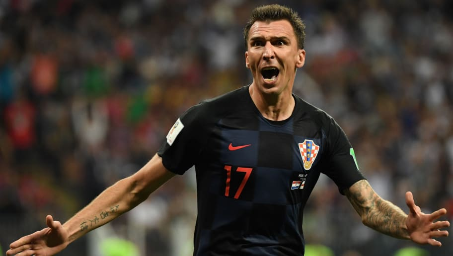 TOPSHOT - Croatia's forward Mario Mandzukic celebrates after scoring his team's second goal during the Russia 2018 World Cup semi-final football match between Croatia and England at the Luzhniki Stadium in Moscow on July 11, 2018. (Photo by YURI CORTEZ / AFP) / RESTRICTED TO EDITORIAL USE - NO MOBILE PUSH ALERTS/DOWNLOADS        (Photo credit should read YURI CORTEZ/AFP/Getty Images)