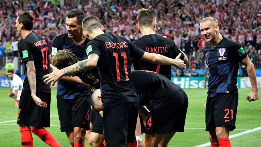 TOPSHOT - Croatia's forward Ivan Perisic (C) is congratulated by teammates after scoring a goal during the Russia 2018 World Cup semi-final football match between Croatia and England at the Luzhniki Stadium in Moscow on July 11, 2018. (Photo by Alexander NEMENOV / AFP) / RESTRICTED TO EDITORIAL USE - NO MOBILE PUSH ALERTS/DOWNLOADS        (Photo credit should read ALEXANDER NEMENOV/AFP/Getty Images)