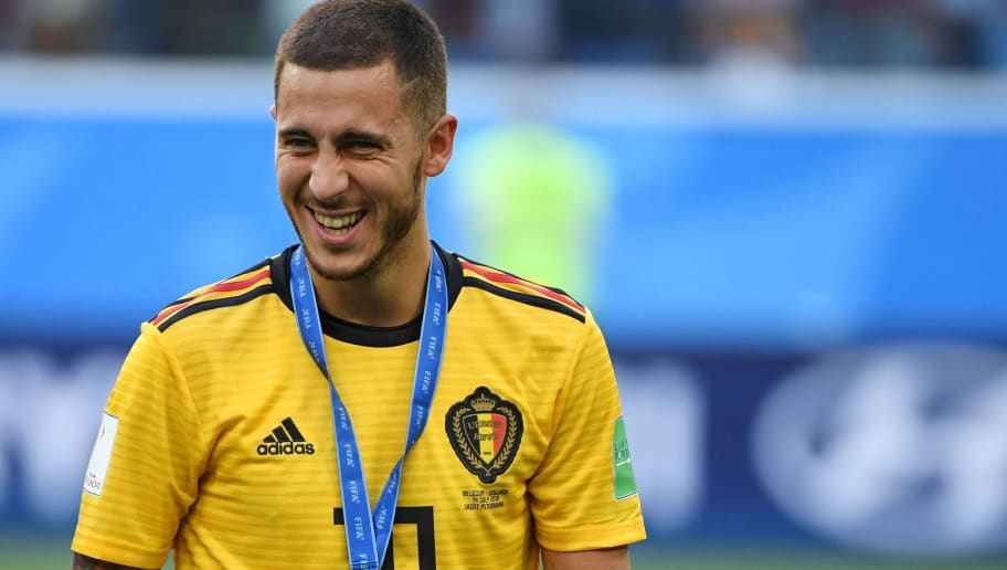 TOPSHOT - Belgium's forward Eden Hazard smiles after receiving his bronze medal following their Russia 2018 World Cup play-off for third place football match between Belgium and England at the Saint Petersburg Stadium in Saint Petersburg on July 14, 2018. (Photo by Paul ELLIS / AFP) / RESTRICTED TO EDITORIAL USE - NO MOBILE PUSH ALERTS/DOWNLOADS        (Photo credit should read PAUL ELLIS/AFP/Getty Images)