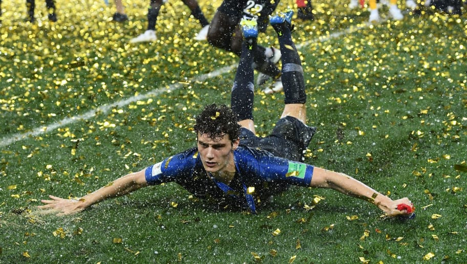 TOPSHOT - France's defender Benjamin Pavard celebrates their win during the trophy ceremony at the end of the Russia 2018 World Cup final football match between France and Croatia at the Luzhniki Stadium in Moscow on July 15, 2018. (Photo by FRANCK FIFE / AFP) / RESTRICTED TO EDITORIAL USE - NO MOBILE PUSH ALERTS/DOWNLOADS        (Photo credit should read FRANCK FIFE/AFP/Getty Images)