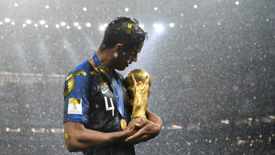 TOPSHOT - France's defender Raphael Varane holds the World Cup trophy after winning the Russia 2018 World Cup final football match between France and Croatia at the Luzhniki Stadium in Moscow on July 15, 2018. (Photo by FRANCK FIFE / AFP) / RESTRICTED TO EDITORIAL USE - NO MOBILE PUSH ALERTS/DOWNLOADS        (Photo credit should read FRANCK FIFE/AFP/Getty Images)