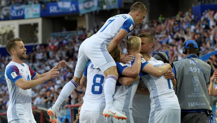 TOPSHOT - Iceland's forward Alfred Finnbogason (hidden) is congratulated by teammates after scoring a goal during the Russia 2018 World Cup Group D football match between Argentina and Iceland at the Spartak Stadium in Moscow on June 16, 2018. (Photo by Juan Mabromata / AFP) / RESTRICTED TO EDITORIAL USE - NO MOBILE PUSH ALERTS/DOWNLOADS        (Photo credit should read JUAN MABROMATA/AFP/Getty Images)