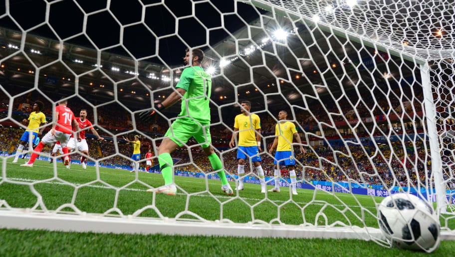 TOPSHOT - Switzerland's midfielder Steven Zuber (#14) scores a goal past Brazil's goalkeeper Alisson during the Russia 2018 World Cup Group E football match between Brazil and Switzerland at the Rostov Arena in Rostov-On-Don on June 17, 2018. (Photo by Pascal GUYOT / AFP) / RESTRICTED TO EDITORIAL USE - NO MOBILE PUSH ALERTS/DOWNLOADS        (Photo credit should read PASCAL GUYOT/AFP/Getty Images)