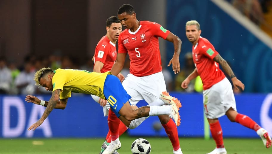 TOPSHOT - Switzerland's defender Manuel Akanji (C) tackles Brazil's forward Neymar during the Russia 2018 World Cup Group E football match between Brazil and Switzerland at the Rostov Arena in Rostov-On-Don on June 17, 2018. (Photo by JOE KLAMAR / AFP) / RESTRICTED TO EDITORIAL USE - NO MOBILE PUSH ALERTS/DOWNLOADS        (Photo credit should read JOE KLAMAR/AFP/Getty Images)