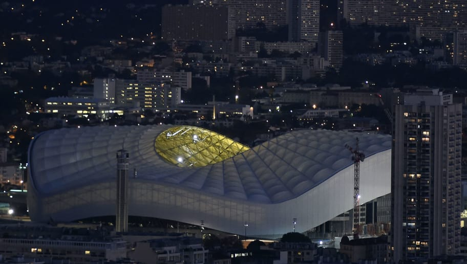 TOPSHOT - The Orange-Velodrome Stadium is pictured at night in Marseille on November 14, 2016. / AFP / BORIS HORVAT        (Photo credit should read BORIS HORVAT/AFP/Getty Images)