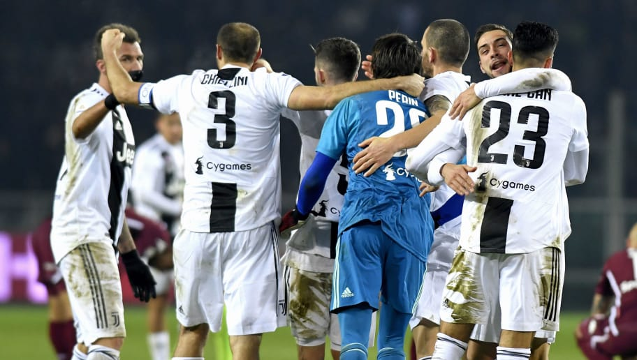 TURIN, ITALY - DECEMBER 15:  Juventus players celebrate victory at the end of the Serie A match between Torino FC and Juventus at Stadio Olimpico di Torino on December 15, 2018 in Turin, Italy.  (Photo by Filippo Alfero/Getty Images)