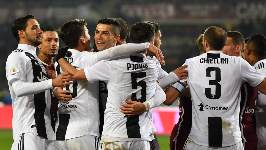 TURIN, ITALY - DECEMBER 15:  Cristiano Ronaldo (C) of Juventus celebrates after scoring the opening goal from the penalty spot with team mates during the Serie A match between Torino FC and Juventus at Stadio Olimpico di Torino on December 15, 2018 in Turin, Italy.  (Photo by Valerio Pennicino/Getty Images)