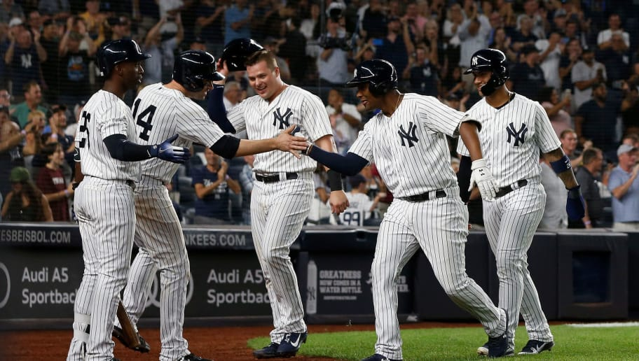 NEW YORK, NY - SEPTEMBER 15:  Miguel Andujar #41 of the New York Yankees celebrates his seventh inning grand slam home run against the Toronto Blue Jays in the dugout with teammates Andrew McCutchen #26, Neil Walker #14, Luke Voit #45 and Gleyber Torres #25 at Yankee Stadium on September 15, 2018 in the Bronx borough of New York City.  (Photo by Jim McIsaac/Getty Images)