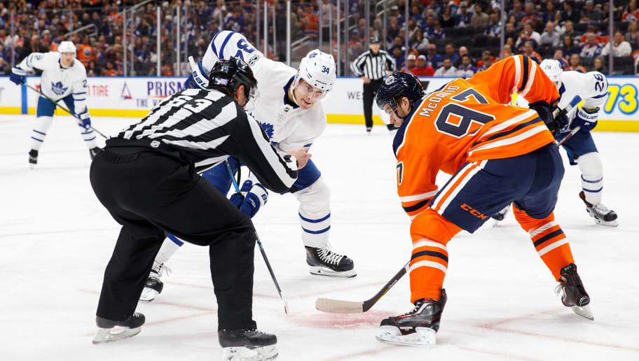 EDMONTON, AB - NOVEMBER 30: Connor McDavid #97 of the Edmonton Oilers faces off against Auston Matthews #34 of the Toronto Maple Leafs at Rogers Place on November 30, 2017 in Edmonton, Canada. (Photo by Codie McLachlan/Getty Images)