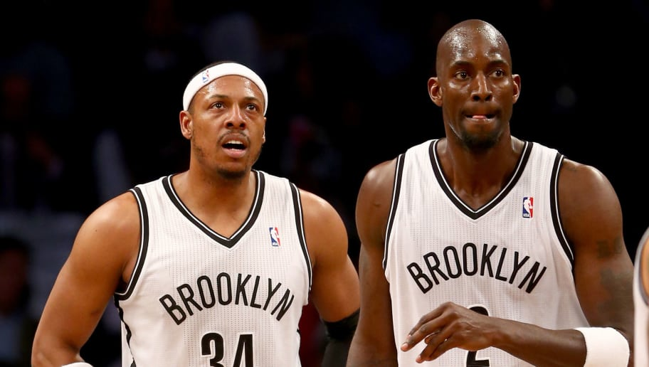 NEW YORK, NY - APRIL 25: Paul Pierce #34 and Kevin Garnett #2 of the Brooklyn Nets walks on the court in the first half against the Toronto Raptors in Game Three of the Eastern Conference Quarterfinals during the 2014 NBA Playoffs at the Barclays Center on April 25, 2014 in the Brooklyn borough of New York City. NOTE TO USER: User expressly acknowledges and agrees that, by downloading and/or using this photograph, user is consenting to the terms and conditions of the Getty Images License Agreement.  (Photo by Elsa/Getty Images)