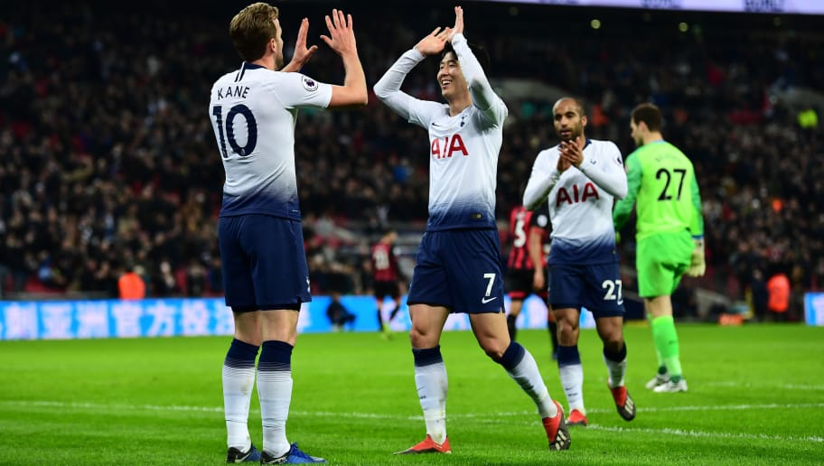 LONDON, ENGLAND - DECEMBER 26:  Harry Kane of Tottenham Hotspur celebrates with Heung-Min Son of Tottenham Hotspur and Lucas Moura of Tottenham Hotspur after he scores his sides 4th goal during the Premier League match between Tottenham Hotspur and AFC Bournemouth at Tottenham Hotspur Stadium on December 26, 2018 in London, United Kingdom.  (Photo by Alex Broadway/Getty Images)