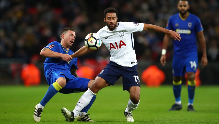 LONDON, ENGLAND - JANUARY 07:  Cody McDonald of AFC Wimbledon and Mousa Dembele of Tottenham Hotspur compete for the ball during The Emirates FA Cup Third Round match between Tottenham Hotspur and AFC Wimbledon at Wembley Stadium on January 7, 2018 in London, England.  (Photo by Julian Finney/Getty Images)
