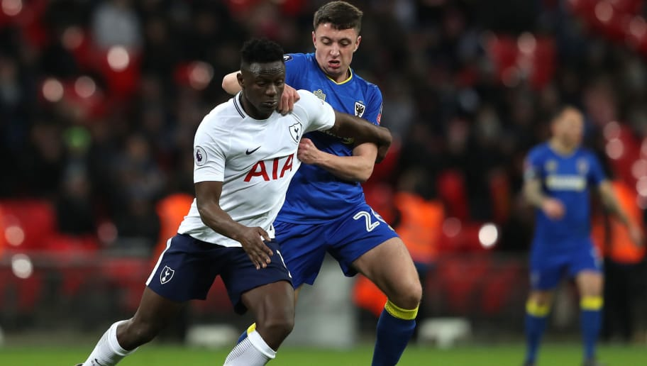 LONDON, ENGLAND - JANUARY 07:  Victor Wanyama of Tottenham Hotspur and Anthony Hartigan of AFC Wimbledon battle for the ball during The Emirates FA Cup Third Round match between Tottenham Hotspur and AFC Wimbledon at Wembley Stadium on January 7, 2018 in London, England.  (Photo by Matthew Lewis/Getty Images)