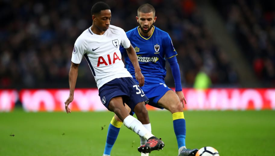 LONDON, ENGLAND - JANUARY 07:  Kyle Walker-Peters of Tottenham Hotspur and George Francomb of AFC Wimbledon during The Emirates FA Cup Third Round match between Tottenham Hotspur and AFC Wimbledon at Wembley Stadium on January 7, 2018 in London, England.  (Photo by Julian Finney/Getty Images)