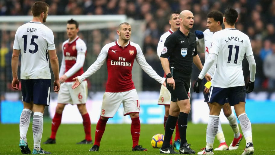 LONDON, ENGLAND - FEBRUARY 10: Referee Anthony Taylor talks with Erik Lamela of Tottenham Hotspur as Jack Wilshere of Arsenal reacts during the Premier League match between Tottenham Hotspur and Arsenal at Wembley Stadium on February 10, 2018 in London, England.  (Photo by Chris Brunskill Ltd/Getty Images)