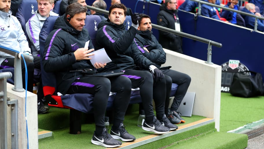 LONDON, ENGLAND - OCTOBER 06: Mauricio Pochettino manager / head coach of Tottenham Hotspur sits with coach Miguel D'Agostino and Jesus Perez before the Premier League match between Tottenham Hotspur and Cardiff City at Wembley Stadium on October 6, 2018 in London, United Kingdom. (Photo by Catherine Ivill/Getty Images)