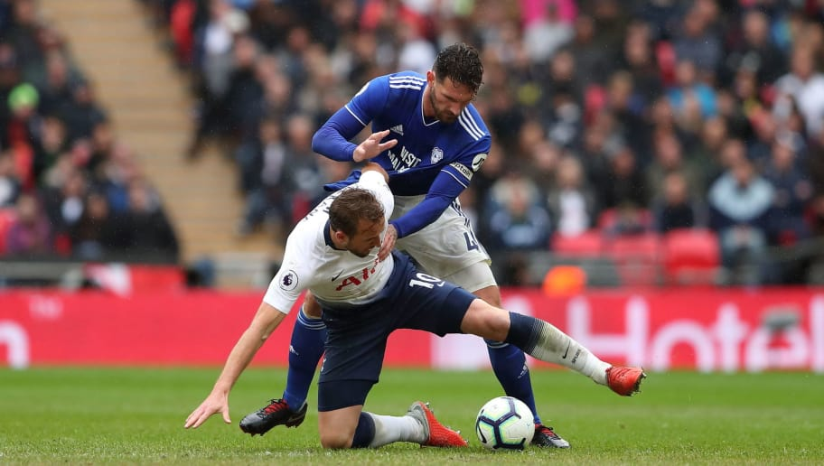 LONDON, ENGLAND - OCTOBER 06: Harry Kane of Tottenham and Sean Morrison of Cardiff City during the Premier League match between Tottenham Hotspur and Cardiff City at Tottenham Hotspur Stadium on October 6, 2018 in London, United Kingdom. (Photo by James Williamson - AMA/Getty Images)