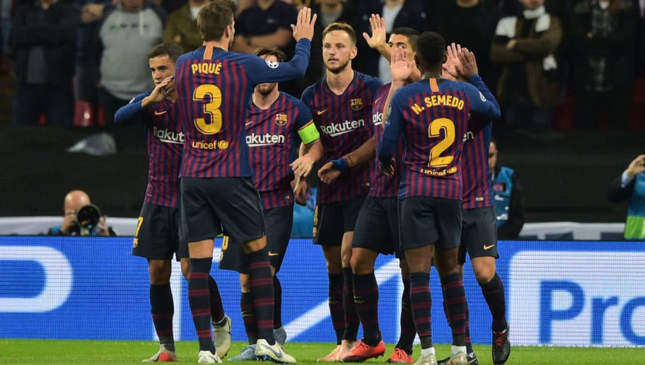 LONDON, ENGLAND - OCTOBER 03: Ivan Rakiti of Barcelona  celebrates after scoring his side second goal with his team mates  during the Group B match of the UEFA Champions League between Tottenham Hotspur and FC Barcelona at Wembley Stadium on October 3, 2018 in London, United Kingdom. (Photo by TF-Images/TF-Images via Getty Images)