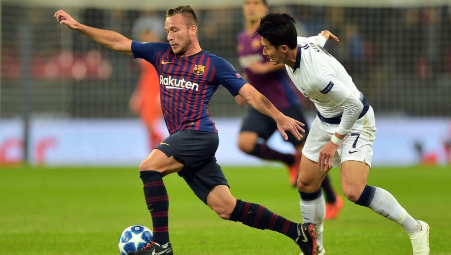 LONDON, ENGLAND - OCTOBER 03: Arthur of Barcelona and Son Heung-Min of Tottenham battle for the ball during the Group B match of the UEFA Champions League between Tottenham Hotspur and FC Barcelona at Wembley Stadium on October 3, 2018 in London, United Kingdom. (Photo by TF-Images/TF-Images via Getty Images)