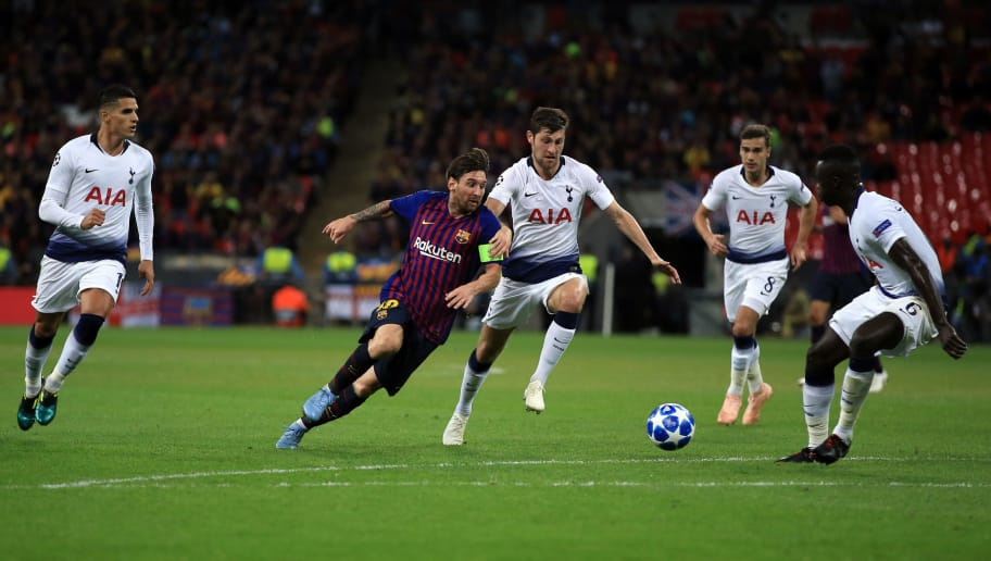 LONDON, ENGLAND - OCTOBER 03: Lionel Messi of FC Barcelona takes on a quartet of Tottenham Hotspur players during the Group B match of the UEFA Champions League between Tottenham Hotspur and FC Barcelona at Wembley Stadium on October 3, 2018 in London, United Kingdom. (Photo by Marc Atkins/Getty Images)