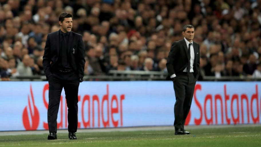 LONDON, ENGLAND - OCTOBER 03: Mauricio Pochettino manager of Tottenham Hotspur alongside FC Barcelona Manager Ernesto Valverde during the Group B match of the UEFA Champions League between Tottenham Hotspur and FC Barcelona at Wembley Stadium on October 3, 2018 in London, United Kingdom. (Photo by Marc Atkins/Getty Images)