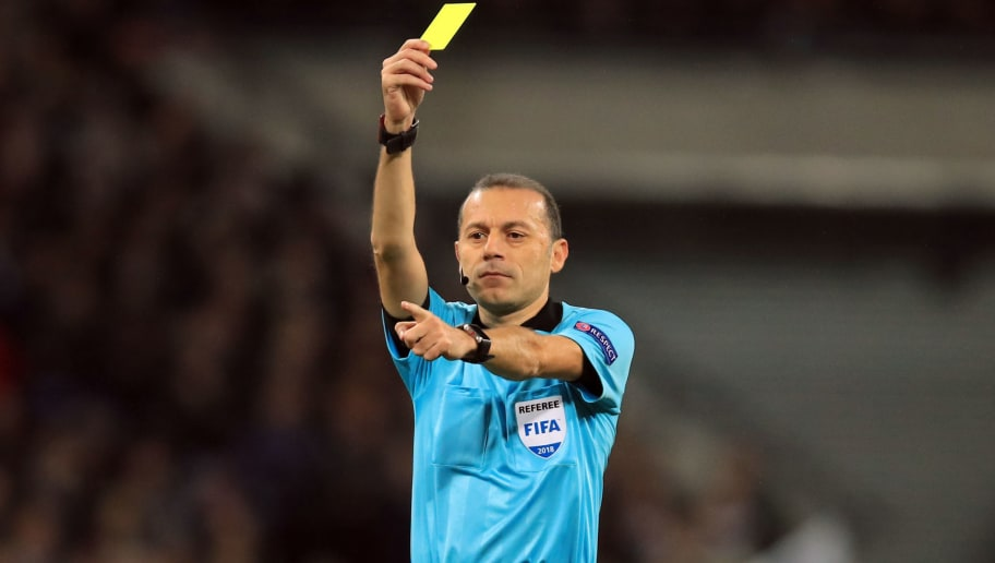 LONDON, ENGLAND - NOVEMBER 28: Referee Cuneyt Cakir shows a yellow card during the Group B match of the UEFA Champions League between Tottenham Hotspur and FC Internazionale at Wembley Stadium on November 28, 2018 in London, United Kingdom. (Photo by Marc Atkins/Getty Images)