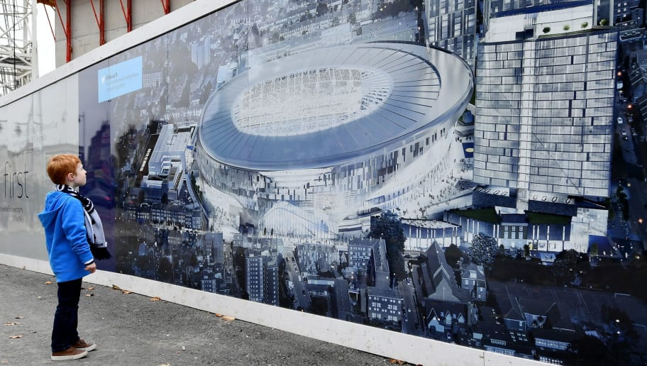 LONDON, ENGLAND - OCTOBER 29: A young fan looks at the plans for the new Tottenham Hotspur stadium prior to kick off during the Premier League match between Tottenham Hotspur and Leicester City at White Hart Lane on October 29, 2016 in London, England.  (Photo by Dan Mullan/Getty Images)