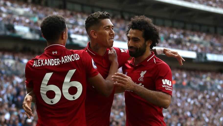 LONDON, ENGLAND - SEPTEMBER 15:  Roberto Firmino of Liverpool celebrates after scoring his team's second goal with Trent Alexander-Arnold and Mohamed Salah of Liverpool during the Premier League match between Tottenham Hotspur and Liverpool FC at Wembley Stadium on September 15, 2018 in London, United Kingdom. during the Premier League match between Tottenham Hotspur and Liverpool FC at Wembley Stadium on September 15, 2018 in London, United Kingdom.  (Photo by Julian Finney/Getty Images)