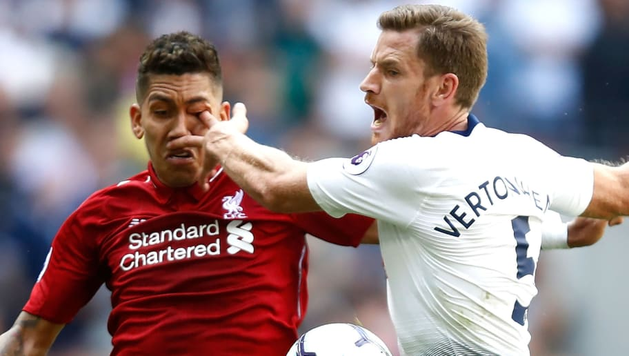 LONDON, ENGLAND - SEPTEMBER 15:  Jan Vertonghen of Tottenham Hotspur pokes Roberto Firmino of Liverpool in the eye as they battle for the ball during the Premier League match between Tottenham Hotspur and Liverpool FC at Wembley Stadium on September 15, 2018 in London, United Kingdom.  (Photo by Julian Finney/Getty Images)