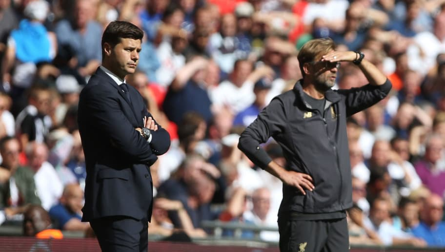 LONDON, ENGLAND - SEPTEMBER 15: Tottenham Manager Mauricio Pochettino and Liverpool Manager Jurgen Klopp look on during the Premier League match between Tottenham Hotspur and Liverpool FC at Wembley on September 15, 2018 in London, United Kingdom. (Photo by Chloe Knott – Danehouse/Getty Images)