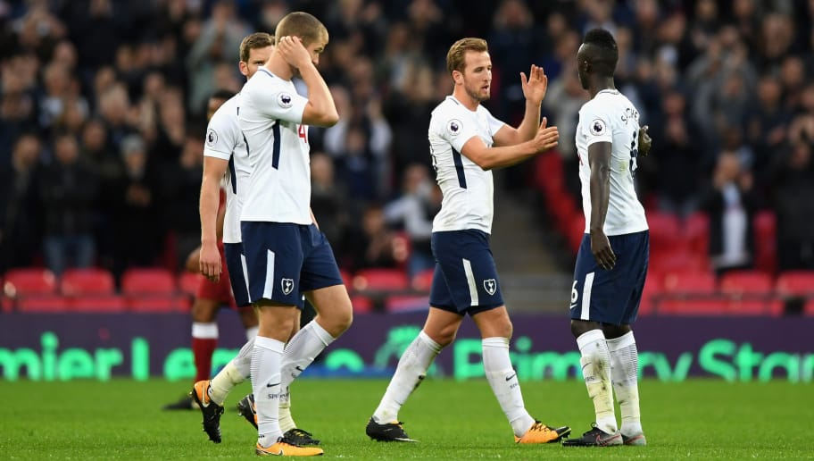 LONDON, ENGLAND - OCTOBER 22: Harry Kane of Tottenham Hotspur and Davinson Sanchez of Tottenham Hotspur celebrate victory after the Premier League match between Tottenham Hotspur and Liverpool at Wembley Stadium on October 22, 2017 in London, England.  (Photo by Shaun Botterill/Getty Images)