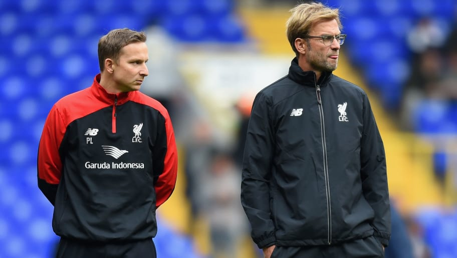 LONDON, ENGLAND - OCTOBER 17:  Jurgen Klopp (R), manager of Liverpool and First-team development coach Pepijn Lijnders (L) look on during the warm-up prior to the Barclays Premier League match between Tottenham Hotspur and Liverpool at White Hart Lane on October 17, 2015 in London, England.  (Photo by Michael Regan/Getty Images)