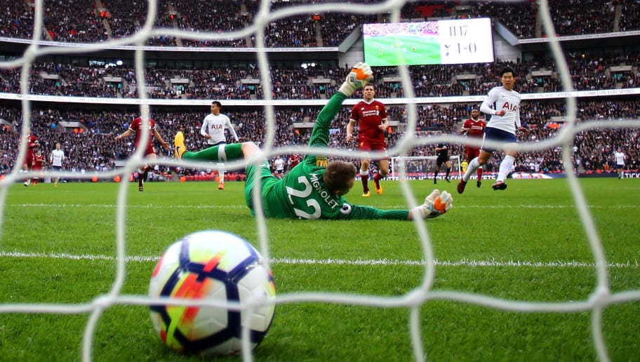 LONDON, ENGLAND - OCTOBER 22: Heung-Min Son of Tottenham Hotspur scores his sides second goal past Simon Mignolet of Liverpool during the Premier League match between Tottenham Hotspur and Liverpool at Wembley Stadium on October 22, 2017 in London, England.  (Photo by Richard Heathcote/Getty Images)