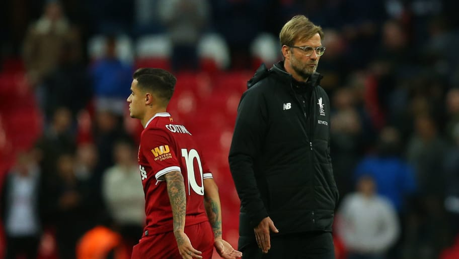 LONDON, ENGLAND - OCTOBER 22: Jurgen Klopp the head coach / manager of Liverpool walks past Philippe Coutinho of Liverpool after the Premier League match between Tottenham Hotspur and Liverpool at Wembley Stadium on October 22, 2017 in London, England. (Photo by Catherine Ivill - AMA/Getty Images)