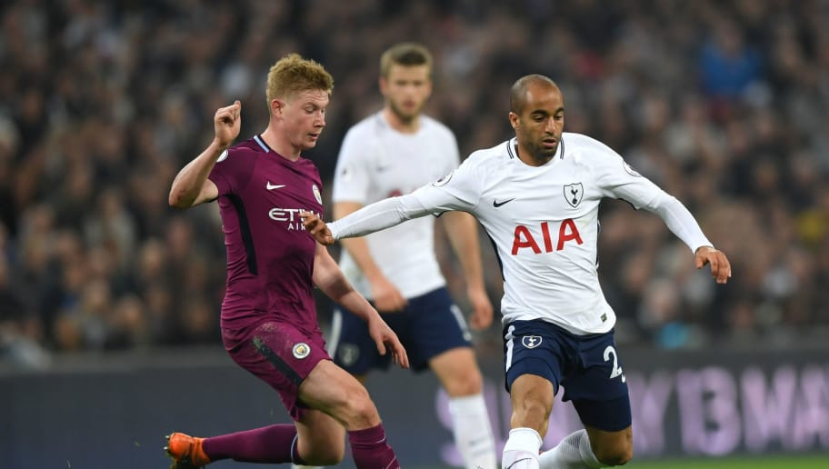 LONDON, ENGLAND - APRIL 14: Lucas Moura of Tottenham Hotspur is challenged by Kevin De Bruyne of Manchester City during the Premier League match between Tottenham Hotspur and Manchester City at Wembley Stadium on April 14, 2018 in London, England.  (Photo by Shaun Botterill/Getty Images)